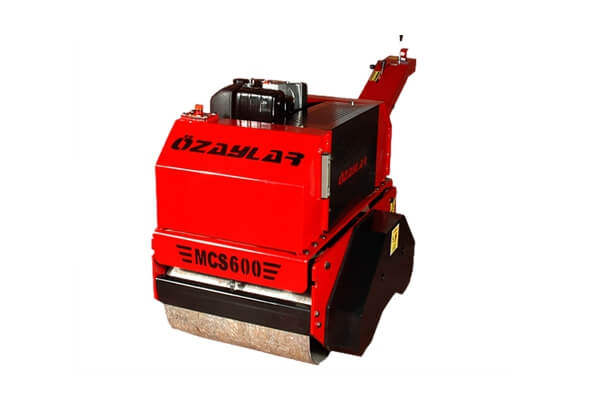 The walk-behind double drum vibrating roller is designed for the compaction of all sorts of soils as well as for the compaction of asphalt and granular material optimally. The roller is used in road construction and repair, compaction of sand-gravel mixtured foundation, paving, sidewalk, canal works, landscaping  and asphalt patch works at narrow spaces.  MCS600 ensures  easy possibility to work with electric starter option and provides easy operation with control system and hydrostatic walk. It also offers high safety with emergency-stop mechanism. Easy to change direction with foldable arm mechanism. Feature built-in water tanks, hydrostatic drive and spray bars and improves working conditions with bidirectional sprinkler system it has. Deadman safety control stops roller when the operator takes hands off the control levers. It provides long-life and economic solution and helping reduce maintenance needs. Walk-Behind Manuel Vibrating Tandem Roller MCS 600